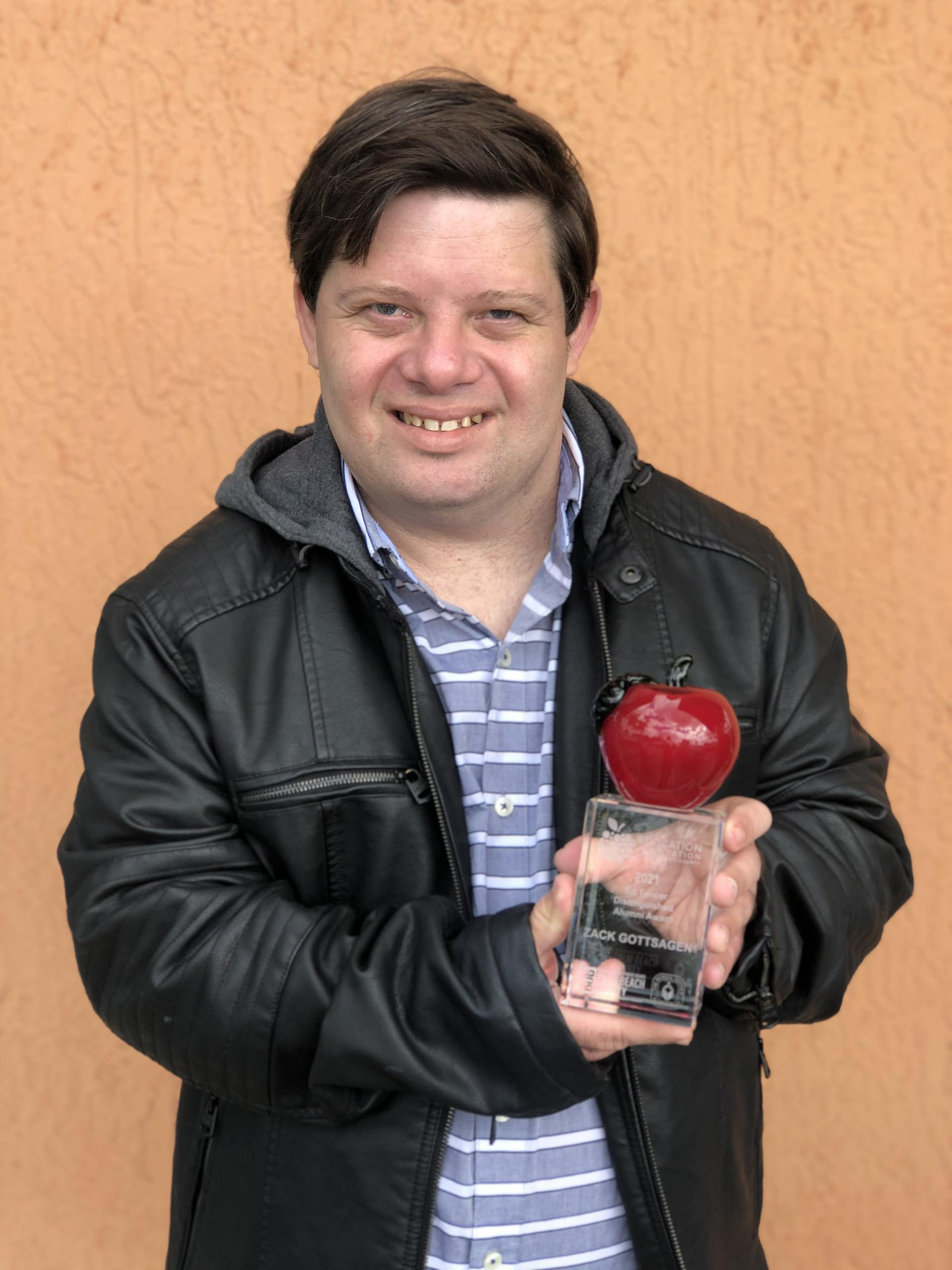 Zack Gottsagen with Alumni Award