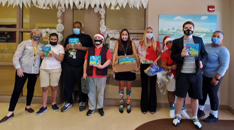 Students from Royal Palm School receive books