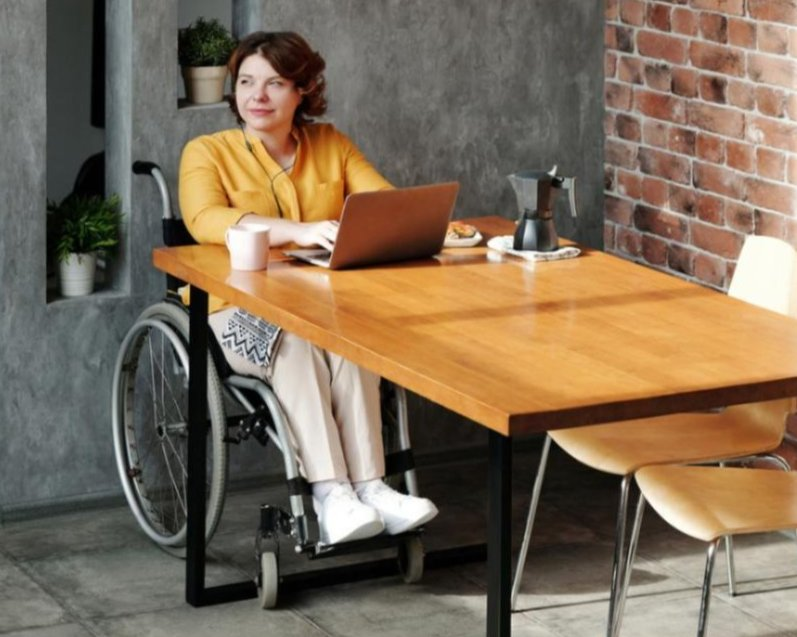 student in wheelchair working on laptop
