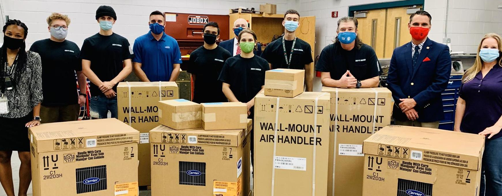 Students, Administrators & EFPBC Staff with HVAC equipment donation