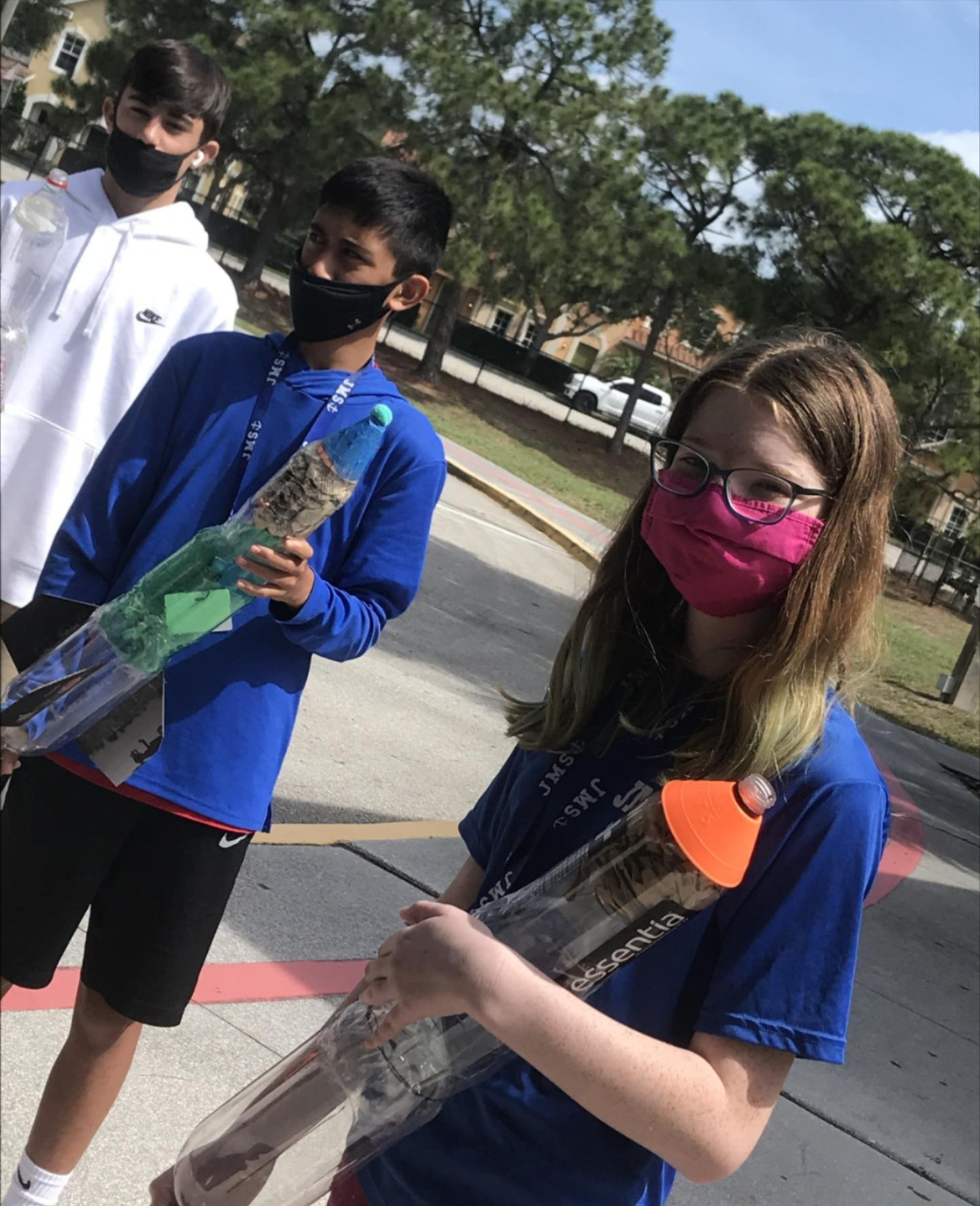 Female student from Jupiter MS Engineering Academy ready to launch the rocket she built through the STEM@Work-granted program