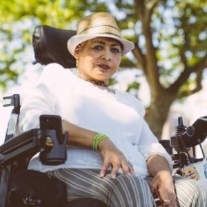 Latina in wheelchair outside